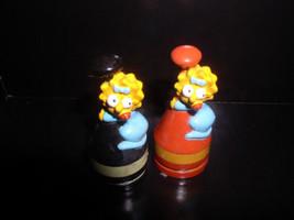 The SimpsonsLisa  Simpson  2 PVC red base and black base Figurines - $19.99