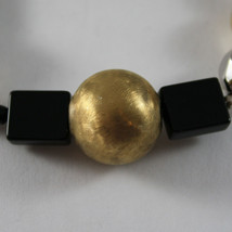 .925 RHODIUM SILVER AND ELASTIC BRACELET WITH BLACK ONYX AND GOLDEN SPHERE image 2
