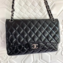 100% Authentic Chanel BLACK QUILTED LAMBSKIN JUMBO CLASSIC DOUBLE FLAP BAG SHW