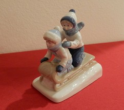 Vintage Porcelana De Cuernavaca Figurine of Children Sledding Collectibl... - $12.50
