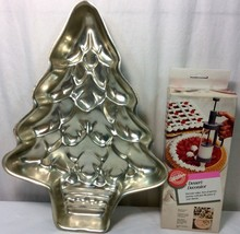 Wilton christmas tree cake pan and Wilton desert decorator - $10.88