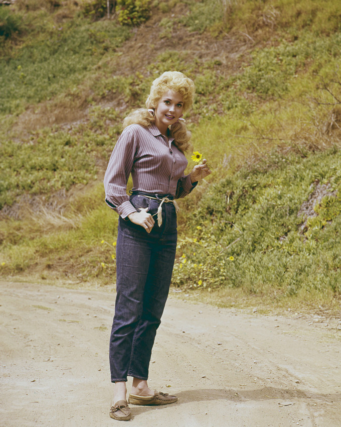 Primary image for Donna Douglas in The Beverly Hillbillies standing in road with flower 16x20 Canv