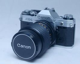 CANON AE-1 Vintage SLR 35mm Film Camera SUPER ALBINAR 135mm f/2.8 FD Len... - $96.00