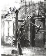 GENE KELLY AUTOGRAPHED B & W PHOTO - CIRCA 1952 - (sku#4887) - $99.88