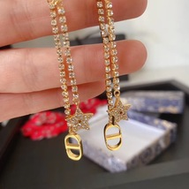 AUTH Christian Dior 2020 GOLD CRYSTAL J'ADIOR DANGLE STAR PEARL EARRINGS  image 8