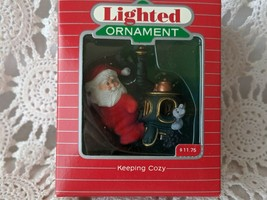 Hallmark Keepsake Magic Lighted Santa Ornament Keeping Cozy 1987 - $8.72