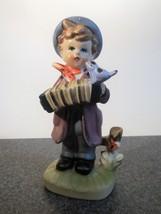 Boy With Accordion and Bird Figurine - $8.59