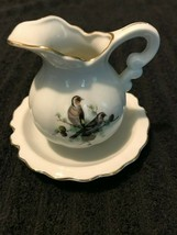 vintage small pitcher with plate has finches on it marked with the no. 184 - $15.00