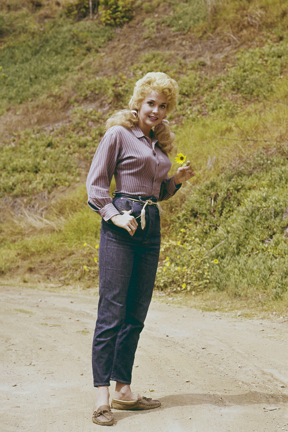 Primary image for Donna Douglas in The Beverly Hillbillies standing in road with flower 18x24 Post