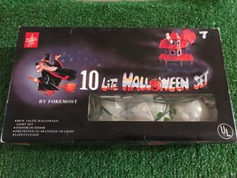 New Set Of Ten Halloween Blow Mold Skull Lights with Green Eyes - $15.83