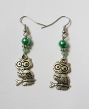 Owl pearched on a branch green silver beaded dangle earrings - $13.00
