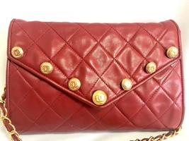 1980s. Vintage CHANEL red lamb leather shoulder bag with golden CC butto... - $2,500.00