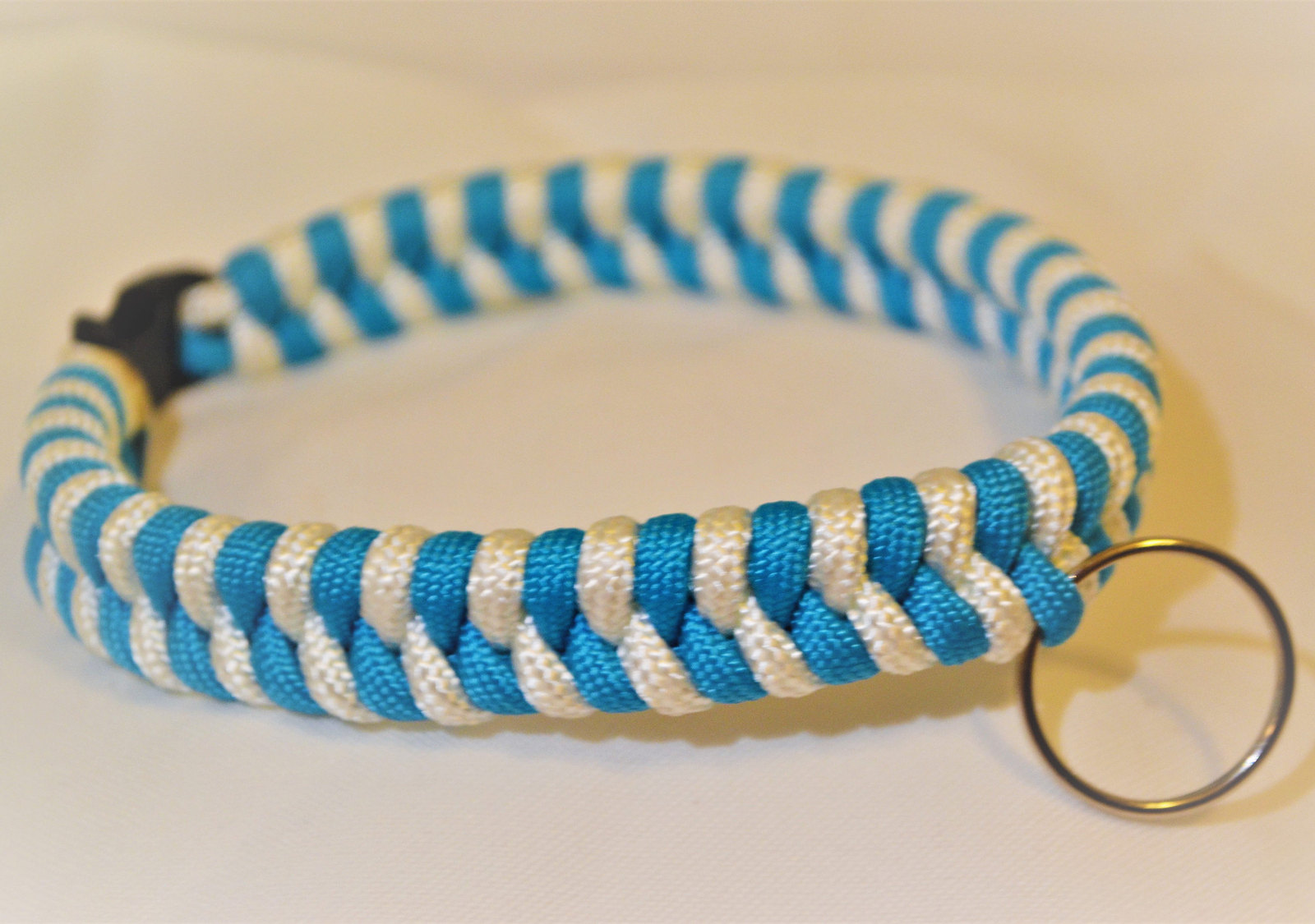 "Primary image for Paracord 550 Dog Collar Teal Blue & White Fish Tail Design 12 1/2"" Black Quick R"
