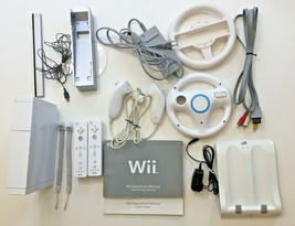 Nintendo Wii Lot Game Console Controllers Nunchucks Steer Wheel Charge S... - $137.61