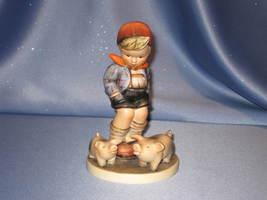 "M. I. Hummel ""Farm Boy"" With Two Pigs Figurine by Goebel. - $110.00"