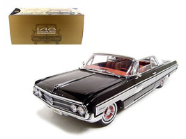 1962 Oldsmobile Starfire Black 1/18 Diecast Car Model by Road Signature - $94.95