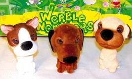 12 ASSORTED BOBBLE HEAD MUTTS bobbing car dash dog moving heads novelty ... - $18.99