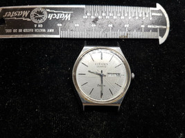 VINTAGE 1984 STEEL CASE CITIZEN 7 QUARTZ DATE WATCH RUNS FOR YOU TO FIX ... - $125.00