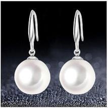 .925 Silver Swarovski Pearl Earrings - $21.00