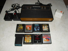 Atari 2600 4 SWITCH with joysticks, adapter, 8 GAMES  pac-man kangaroo and more - $148.49