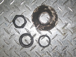 SUZUKI 1988 QUAD RUNNER 300 2X4 REAR AXLE NUTS AND SPACERS  (BIN 32)   P... - $15.00