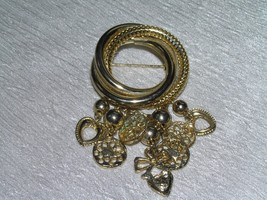Vintage Tubular Goldtone Interlocking Circles with Flower Medallion Hear... - $8.59