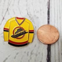 Vintage NHL Vancouver Canucks Yellow Jersey Shirt Metal Pin Button Lapel  - $12.37