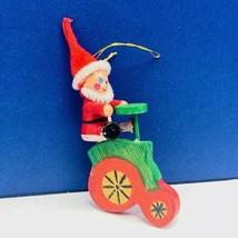 Christmas ornament 1980s wood holiday vintage mcm Santa Claus bicycle bi... - $14.80