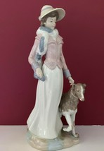 NADAL LLADRO #853 LADY WOMAN FIGURINE WITH BONNET & SCARF WALKING DOG - $227.69