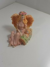 6 inch resin sitting angel with baby in manger - $9.90