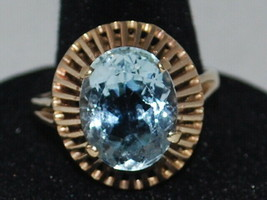 10k Yellow Gold Ring With A Solitaire Blue Topaz (December birthstone)  - $295.60