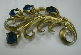 Gold color metal with blue rhinestones brooch - $12.86