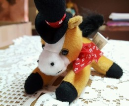 Four and a half inch stuffed horse black and red hat with stars red scarf - $8.04