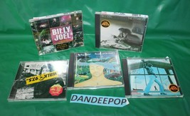 5 Assorted Billy Joel Music CD's  - $39.59