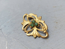 Vintage golden brooch with green crystals Vintage green rhinestones broo... - $25.00