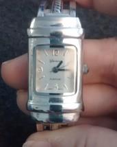Geneva Platinum 7106 Ladies' Wristwatch silvertone filigree watch - $6.99