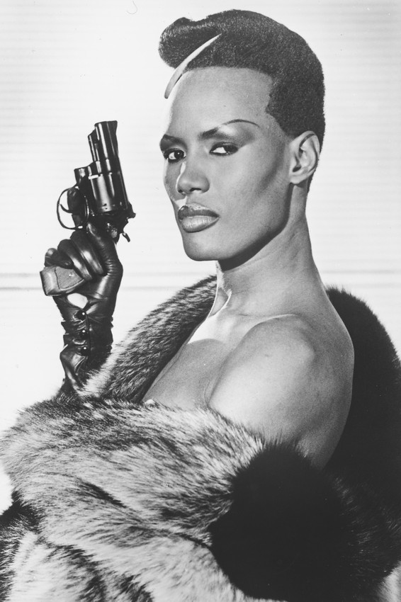 Primary image for Grace Jones cool pose with gun and fur coat 18x24 Poster