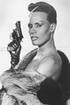 Grace Jones cool pose with gun and fur coat 18x24 Poster - $23.99