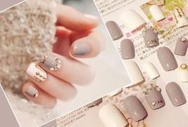 Moon and stars cream and light brown 24 pc aritifical nails set in short length - $14.95