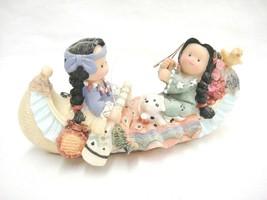 Native Girls in Canoe Fishing Figurine Dalmatian Puppy Bird Flowers Long... - $12.86
