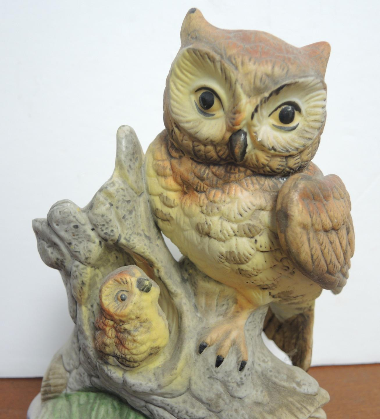 Vintage Mother and Baby Owl Standing on Hollowed Trunk