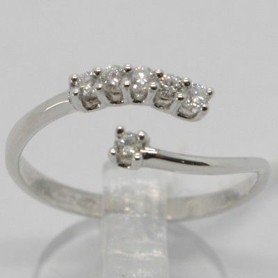 WHITE GOLD RING 750 18K, OPEN, SOLITAIRE AND A ROW OF DIAMONDS, CARAT 0.18