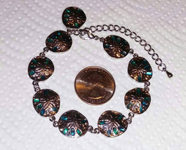 Abalone shell inlay sand dollar bracelet is an adjustable 10.50 inches l... - $9.00