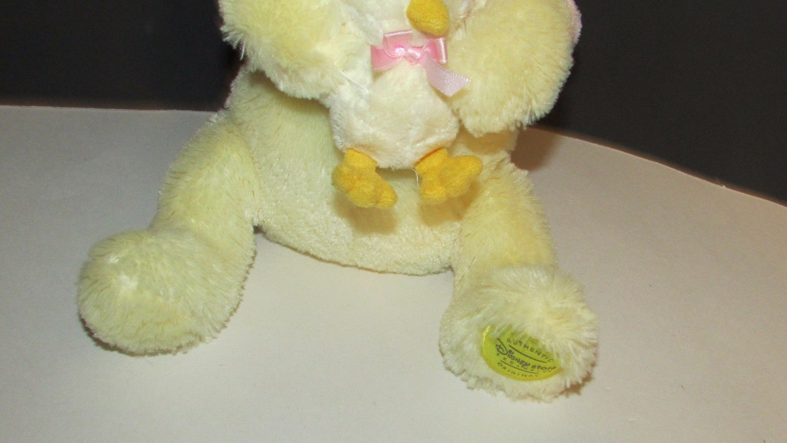 Disney store Winnie The Pooh Plush yellow pink shirt holding baby chick Easter