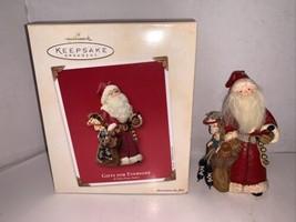 HALLMARK KEEPSAKE ORNAMENT Gifts For Everyone A Visit From Santa 2003 - $10.00