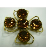 Large whiskey colored rhinestones on large brooch marked Freirich - $59.40