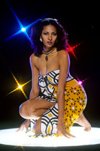 Pam Grier barefoot with spotlights on stand 18x24 Poster - $23.99