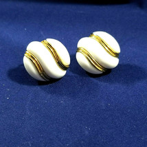 Trifari Vtg Pair of Clip Earrings White With Gold Backing and Swirls - $11.29