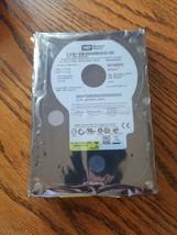 WD740ADFD-00NLR1, DCM HBCA2AB, Western Digital 74GB SATA 3.5 Hard Drive - $81.18
