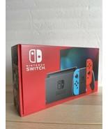 Nintendo Switch w/ Neon Blue & Red Joy‑Con Grey 32GB - $365.31